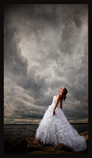 Look at that sky.  While the day was overcast, the clouds had an interesting shape and texture.  Now look at the bride's dress.  In its skirt, you'll see similar shapes and textures.  What a perfect opportunity to bring them together in the composition!